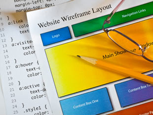 Image of a website design wireframe and CSS code